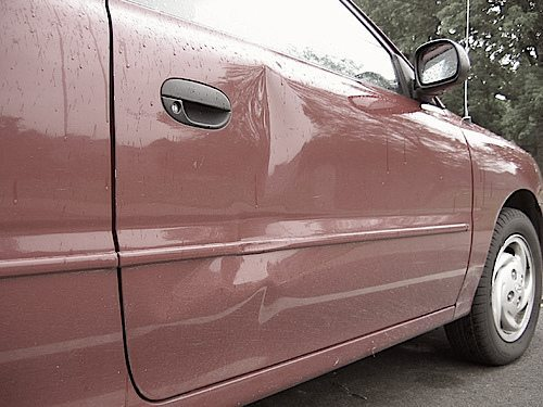Paintless Dent Removal vs. Traditional Dent Removal