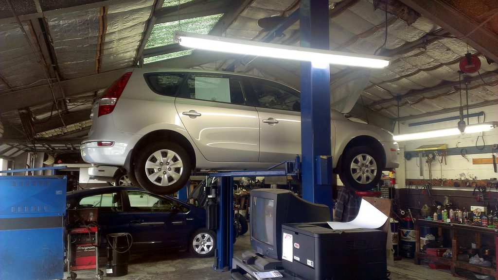 car maintenance on a lift